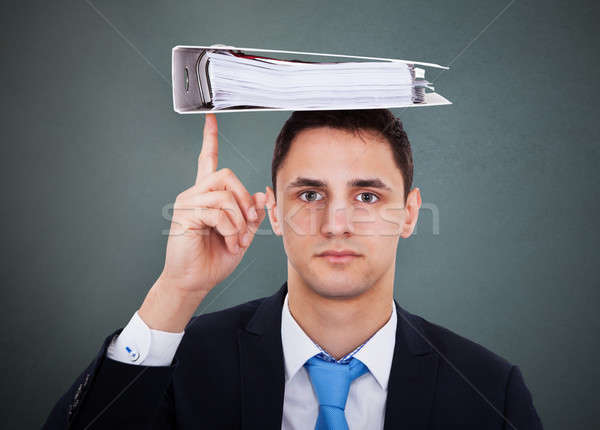 Businessman Balancing Binder On Head Stock photo © AndreyPopov