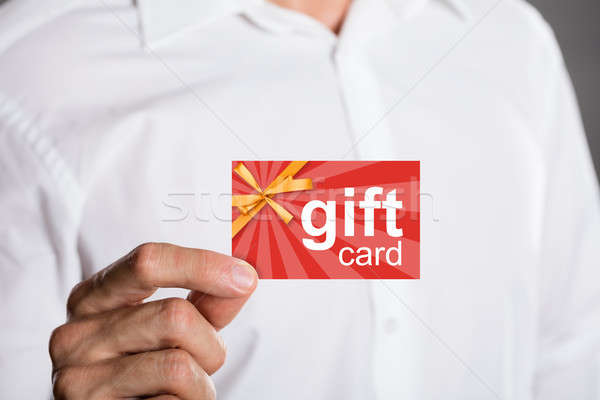 Man Holding Gift Card Stock photo © AndreyPopov