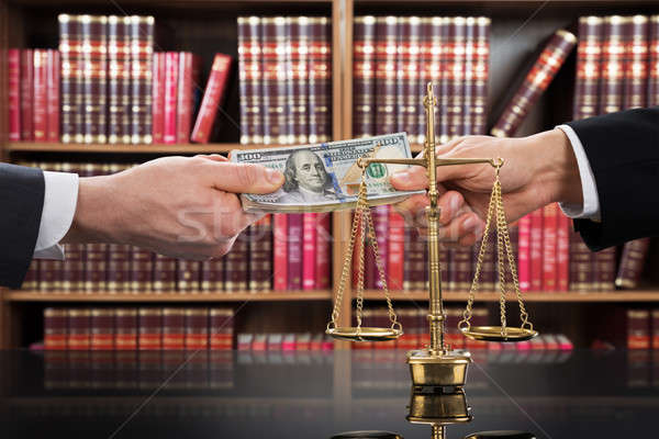 Justice Scale With Judge Taking Bribe From Client Stock photo © AndreyPopov