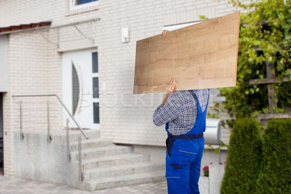 Mover Carrying Piece Of Furniture Stock photo © AndreyPopov