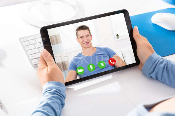Woman Doing Video Chatting With A Man Stock photo © AndreyPopov