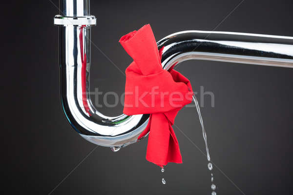 Red Cloth Tied On Leakage Pipe Stock photo © AndreyPopov