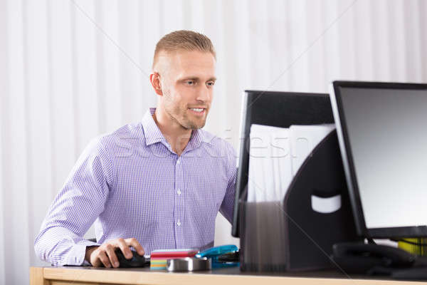 Confident Young Businessman Using Computer Stock photo © AndreyPopov