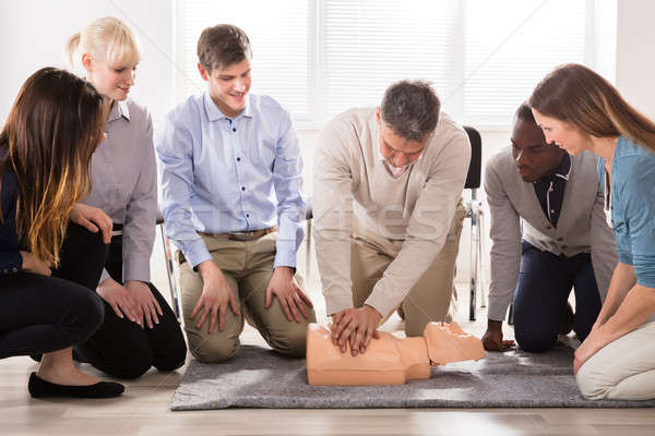 Instructor Performing Resuscitation Technique On Dummy Stock photo © AndreyPopov