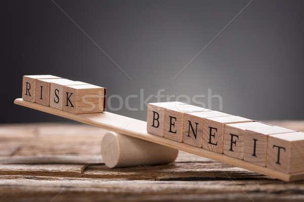 Közelkép kockázat haszon fakockák hinta szürke Stock fotó © AndreyPopov