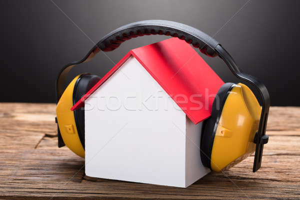 Model Home With Ear Protectors On Table Stock photo © AndreyPopov