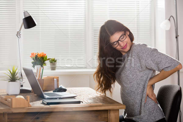 Businesswoman Having Back Pain Stock photo © AndreyPopov
