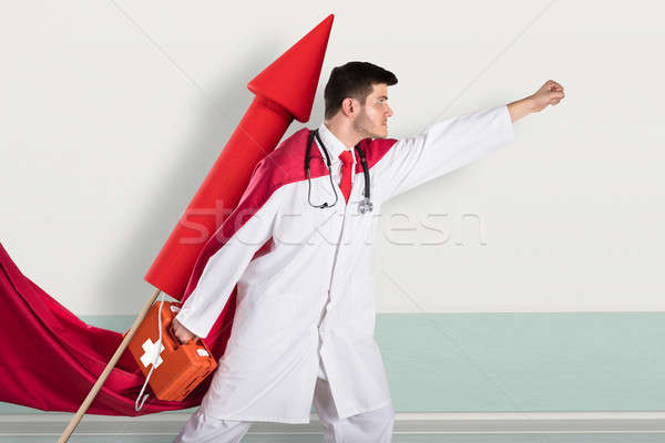 Superhero Doctor With First Aid Box While Flying On Rocket Stock photo © AndreyPopov