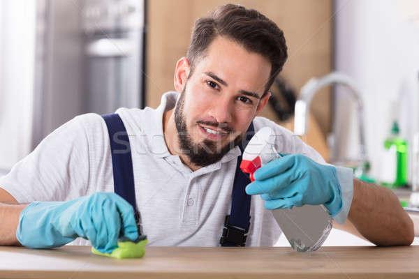 Man Cleaning Kitchen Worktop Stock photo © AndreyPopov