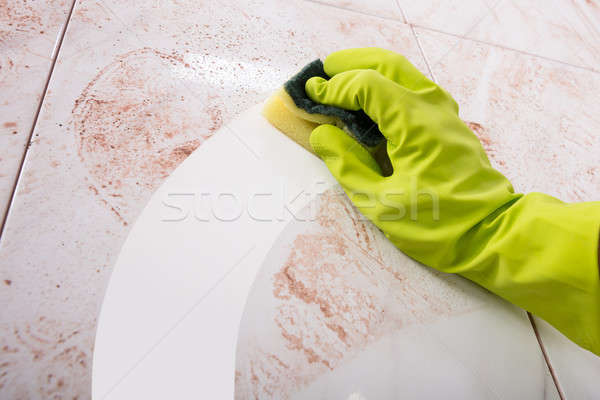 Hands In Rubber Gloves Scrubbing Kitchen Stock photo © AndreyPopov