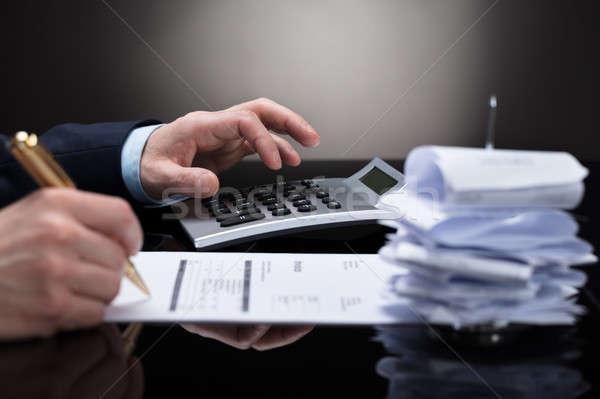 Businessperson Checking Invoice Stock photo © AndreyPopov