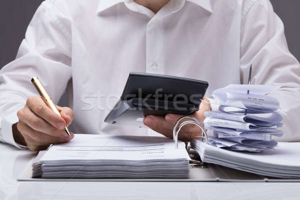 Businesswoman Calculating Tax Stock photo © AndreyPopov