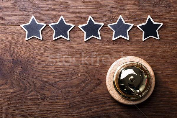 Vijf sterren dienst bel houten bureau Stockfoto © AndreyPopov