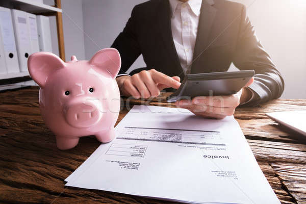 Stock photo: Businessperson Checking Invoice In Office