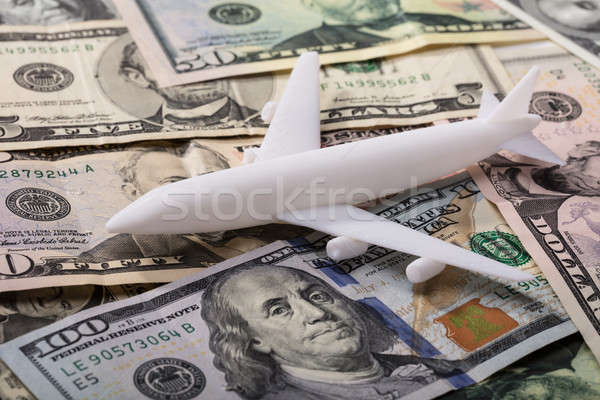 Airplane On Dollar Banknotes Stock photo © AndreyPopov