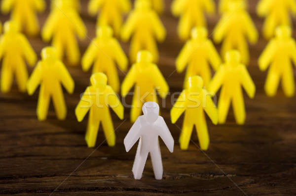 Elevated View Of White Figure Leading Yellow Human Figures Stock photo © AndreyPopov