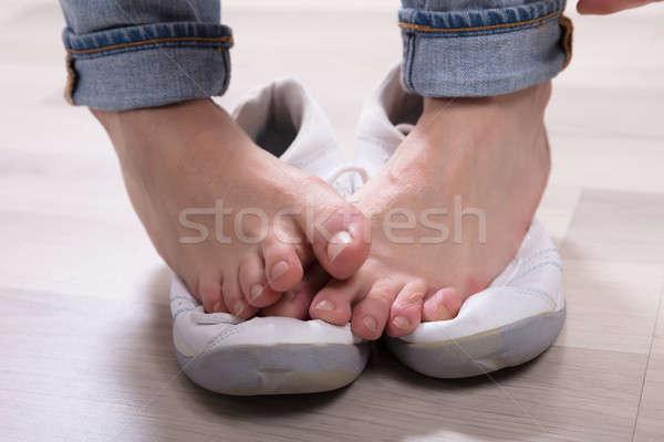 Woman's Leg Over Footwear Stock photo © AndreyPopov