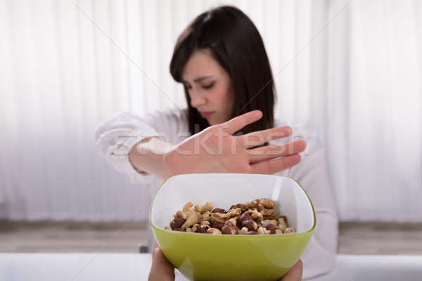 Woman Refusing Nut Food Stock photo © AndreyPopov
