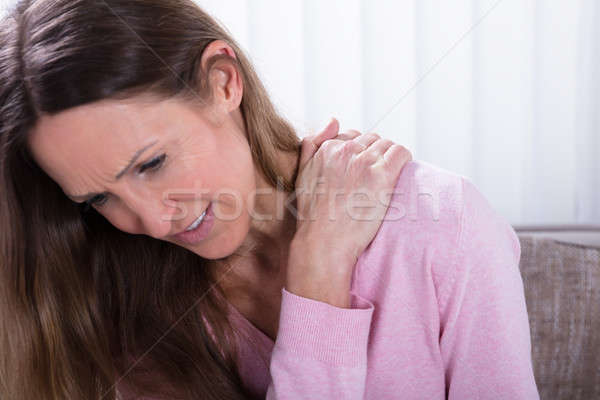 Mature Woman Suffering From Backache Stock photo © AndreyPopov