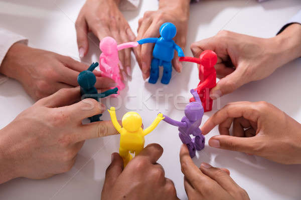 Group Of Businesspeople Holding Human Figures Stock photo © AndreyPopov