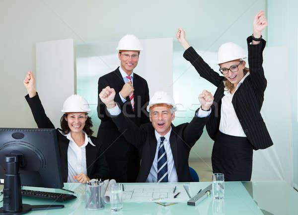 Cheering architectural team Stock photo © AndreyPopov