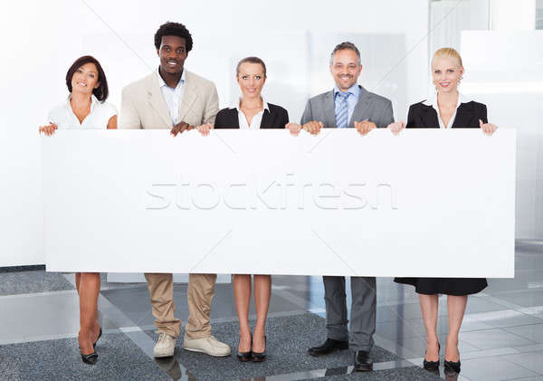 Multiracial Businesspeople Holding Placard Stock photo © AndreyPopov
