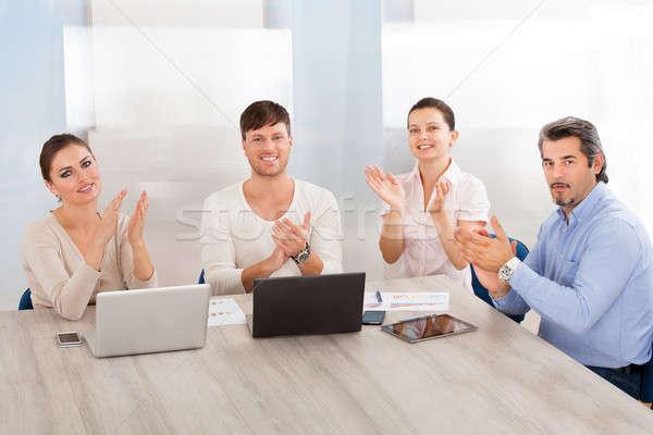 üzleti csoport tapsol tapsol mosolyog üzlet nő Stock fotó © AndreyPopov