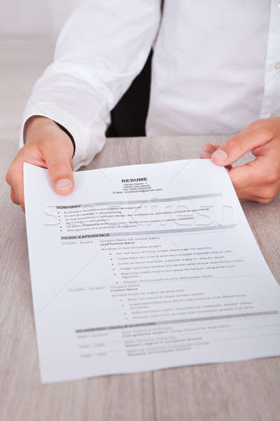 üzletember tart önéletrajz közelkép kéz asztal Stock fotó © AndreyPopov