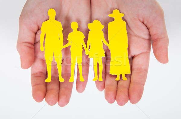 Male Hand Holding Family Cutout Shape Stock photo © AndreyPopov