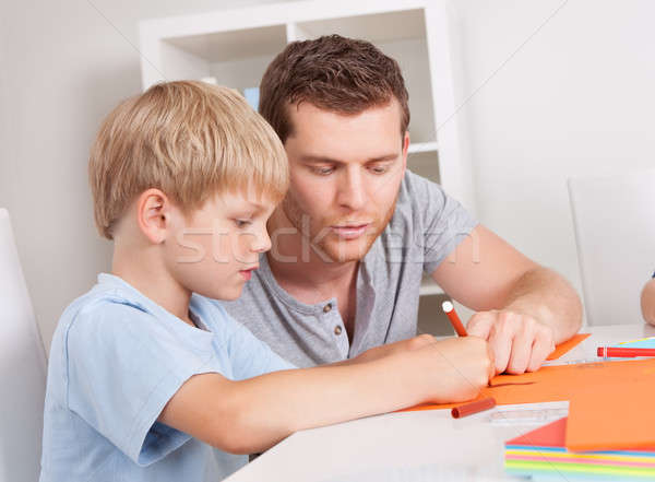 Young family drawing with colorful pencils Stock photo © AndreyPopov