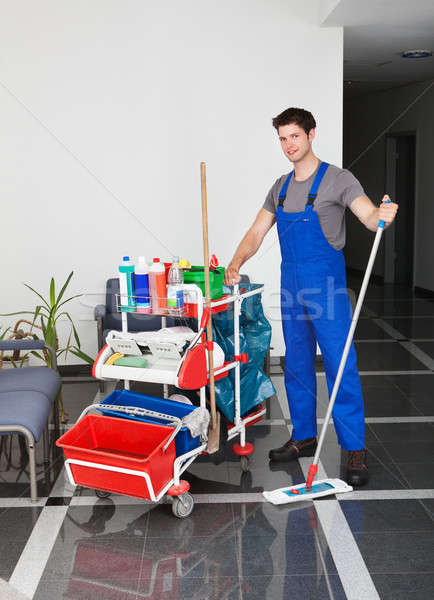 Young Man With Cleaning Equipment Stock photo © AndreyPopov