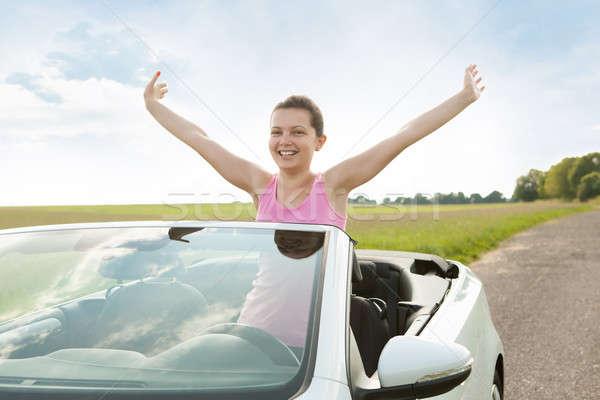Woman Raising Hand In Car Stock photo © AndreyPopov