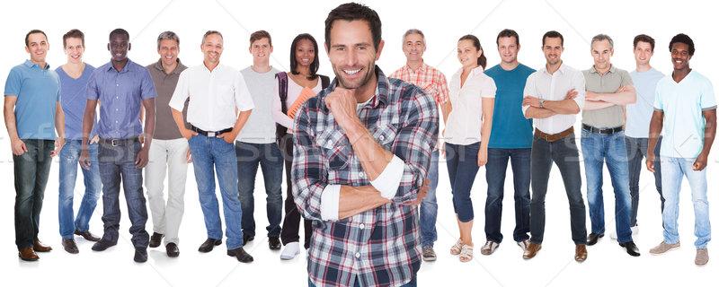 Różnorodny ludzi stałego biały człowiek szczęśliwy Zdjęcia stock © AndreyPopov