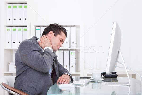 Businessman Suffering From Neck Pain Stock photo © AndreyPopov