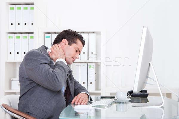 Empresario sufrimiento dolor de cuello jóvenes negocios Foto stock © AndreyPopov
