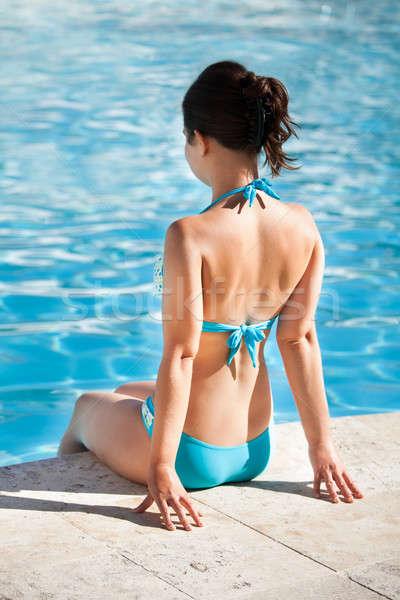 Fiatal nő ül perem úszómedence hátsó nézet víz Stock fotó © AndreyPopov