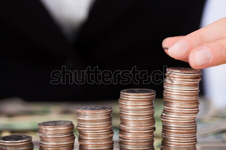 Businesswoman Arranging Coins As Bar Graph Stock photo © AndreyPopov