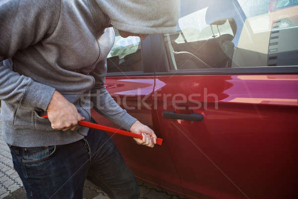Thief Opening Car's Door With Crowbar Stock photo © AndreyPopov