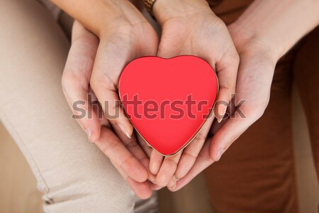 Stock photo: Couple Holding Heart Shape In Cupped Hands