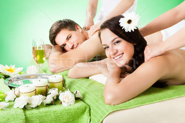 Smiling Couple Receiving Shoulder Massage At Beauty Spa Stock photo © AndreyPopov