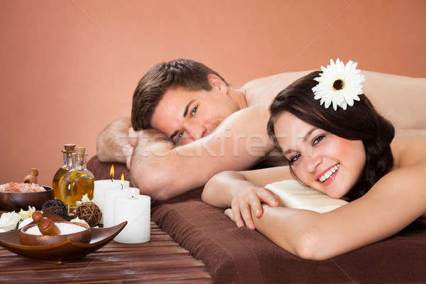 Smiling Couple Relaxing In Beauty Spa Stock photo © AndreyPopov