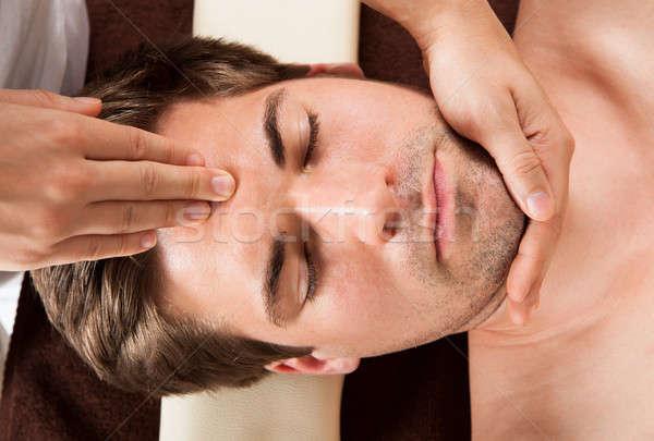 Młody człowiek czoło masażu spa bezpośrednio powyżej Zdjęcia stock © AndreyPopov