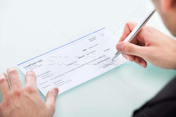 Affaires signature chèque jeunes remplissage Photo stock © AndreyPopov