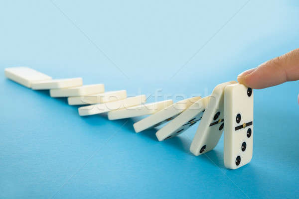 Persona parada caer dominó primer plano dedo Foto stock © AndreyPopov