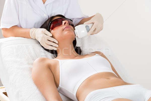 Beautician Giving Epilation Laser Treatment Stock photo © AndreyPopov