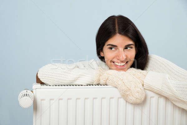 Nő pulóver dől radiátor fiatal boldog Stock fotó © AndreyPopov