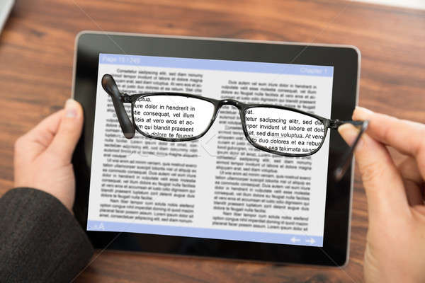 Person Reading E-book With Spectacles Stock photo © AndreyPopov