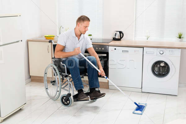 Disabled Man On Wheelchair Cleaning Floor Stock photo © AndreyPopov