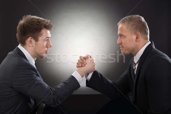 Twee jonge zakenman arm worstelen Stockfoto © AndreyPopov