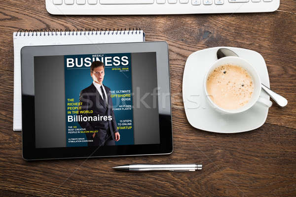 Digital Tablet Showing Magazine Cover With Cup Of Tea Stock photo © AndreyPopov